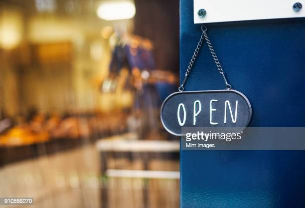 close up of open sign on glass door to a bakery. - cartello chiuso foto e immagini stock