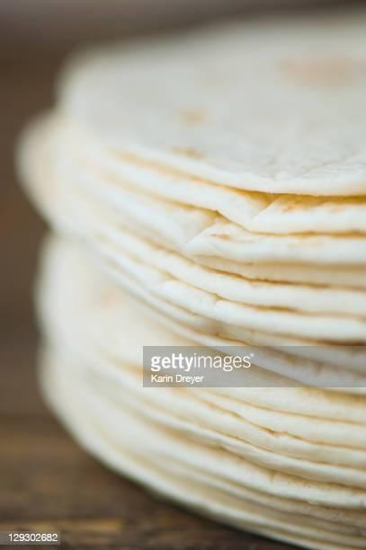 close up of organic flour tortillas - tortilla flatbread stock photos and pictures