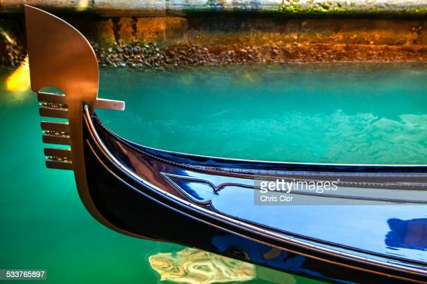 Close up of ornate gondola decoration on canal