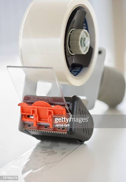 close up of packing tape - tape dispenser stock photos and pictures
