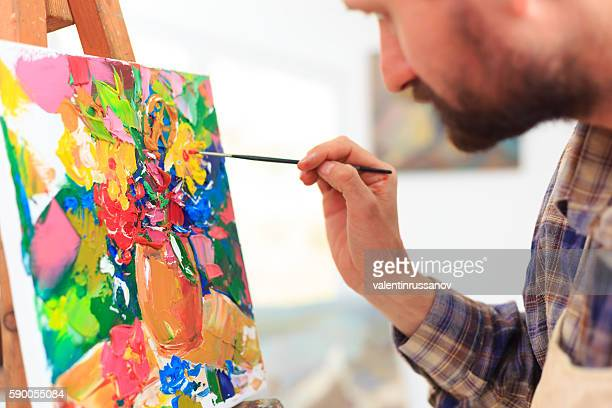 Close up of painter creating art at his workshop