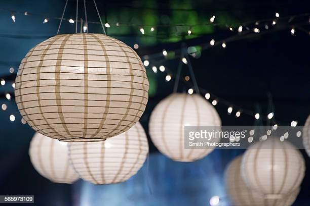 Close up of paper lanterns and string lights at night