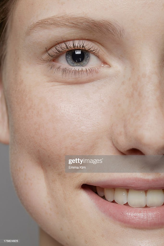 Close up of part of young woman's face, smiling : Stock-Foto