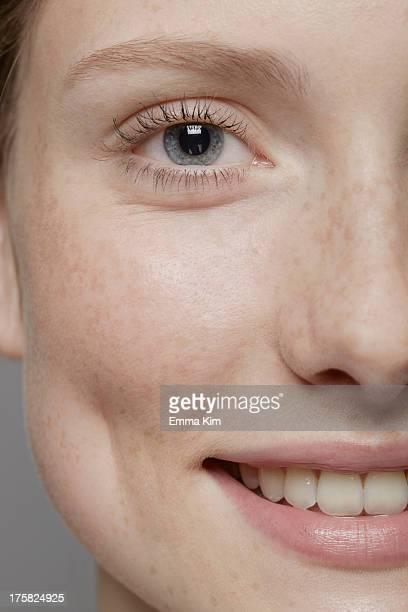 close up of part of young woman's face, smiling - lichaamsverzorging en schoonheid stockfoto's en -beelden