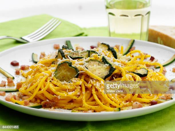 Close up of pasta with zucchini and cheese