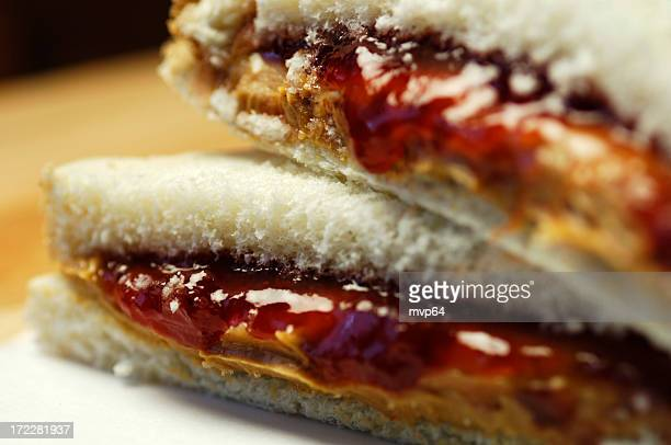 close up of peanut butter and jelly sandwich on white bread - peanut butter and jelly sandwich stock pictures, royalty-free photos & images