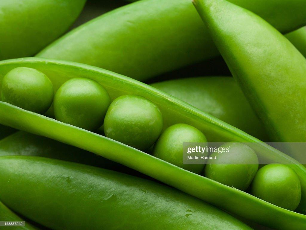 Close up of peas in pea pod : Stock Photo