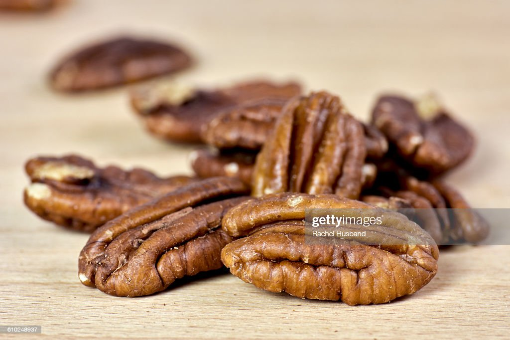 Close up of pecan nuts on chopping board : Stock Photo