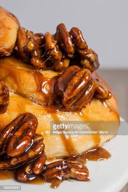 Close up of pecans on sticky buns