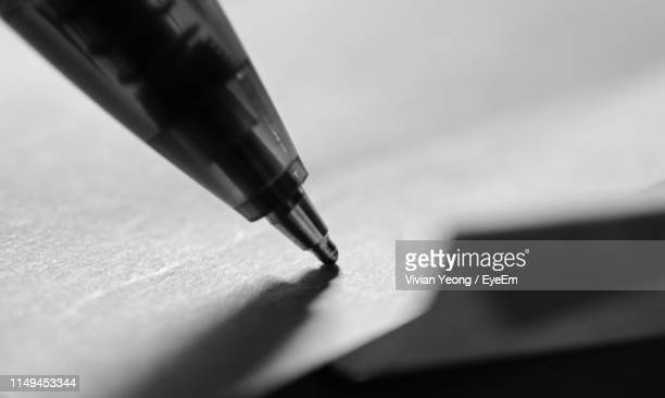 close up of pen on paper - ballpoint pen stock pictures, royalty-free photos & images