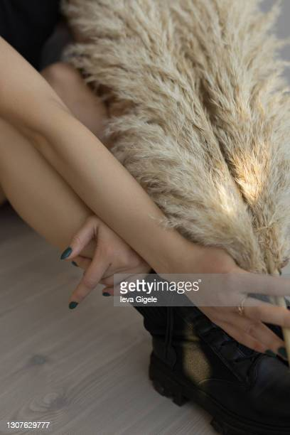 close up of people body part woman holding in hands dried branches - black nail polish stock pictures, royalty-free photos & images