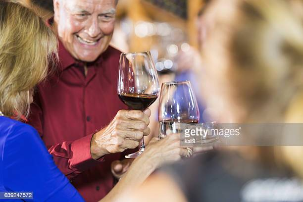 Close up of people drinking, toasting at party