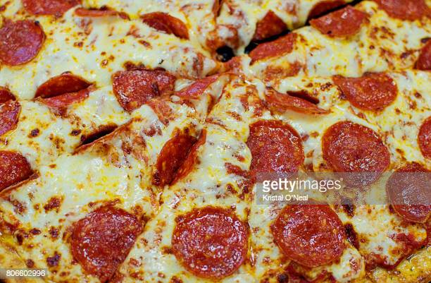 close up of pepperoni pizza - pepperoni stock photos and pictures