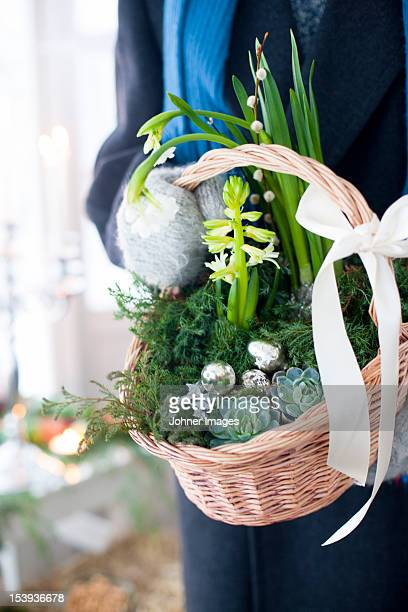 Close up of person holding Christmas basket