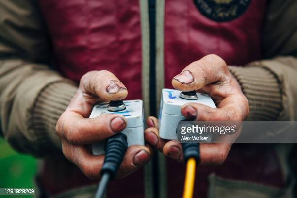 close up of person holding switches - gunman stock pictures, royalty-free photos & images