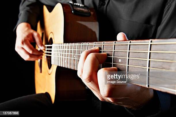 close up of person playing classical guitar - classical guitar stock photos and pictures