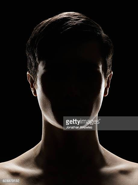 close up of person with obscured face - back lit stock pictures, royalty-free photos & images