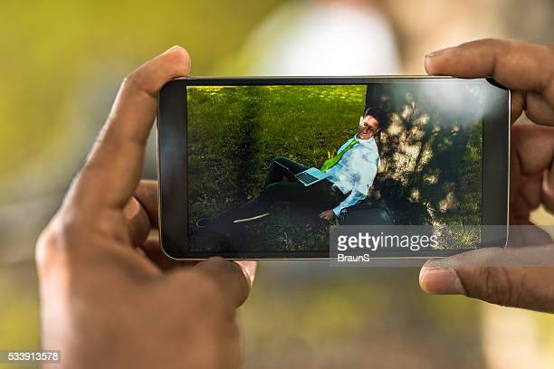 Close up of photographing a sleepy businessman in nature.