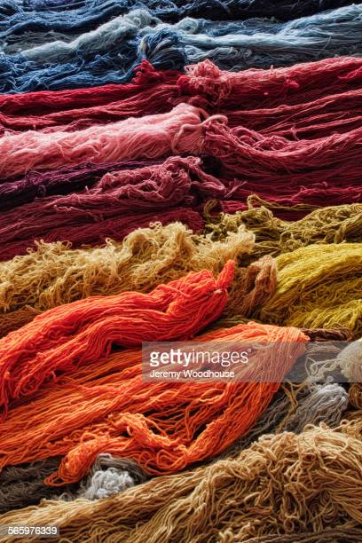 close up of piles of dyed thread - dye stock pictures, royalty-free photos & images