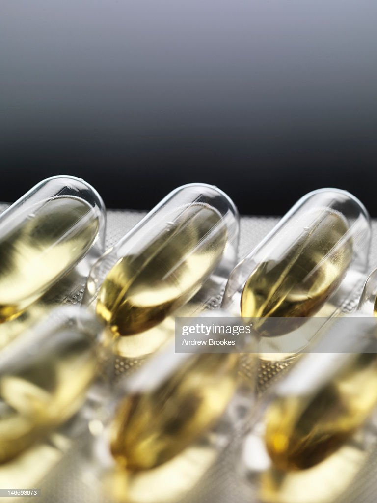 Close up of pills in blister pack : Stock Photo