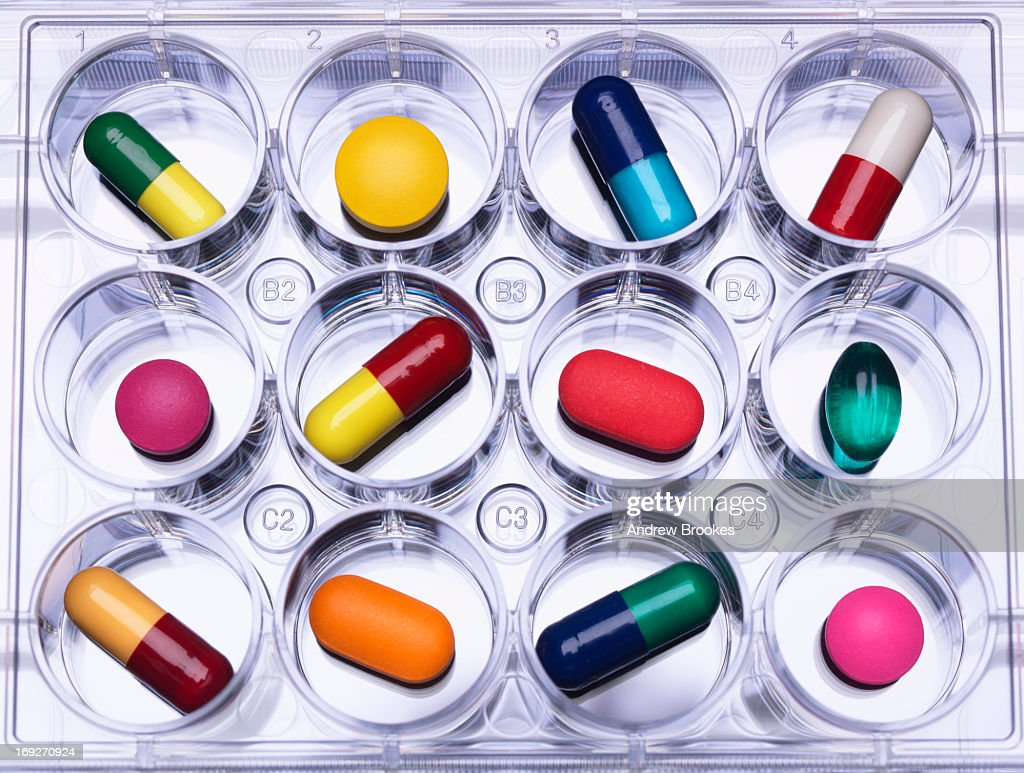 Close up of pills in sample tray : Stock Photo