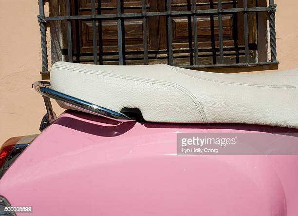 close up of pink scooter against an old window - lyn holly coorg stock pictures, royalty-free photos & images