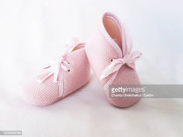 close up of pink shoes - baby booties stock photos and pictures