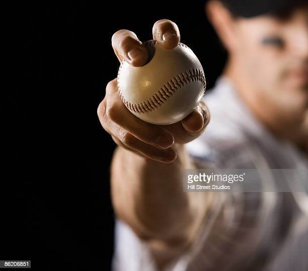 close up of pitcher holding baseball - baseball pitcher stock pictures, royalty-free photos & images