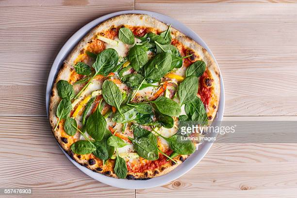 Close up of pizza with fresh spinach
