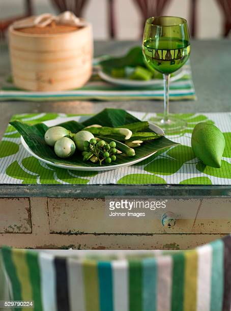 Close up of place setting in green