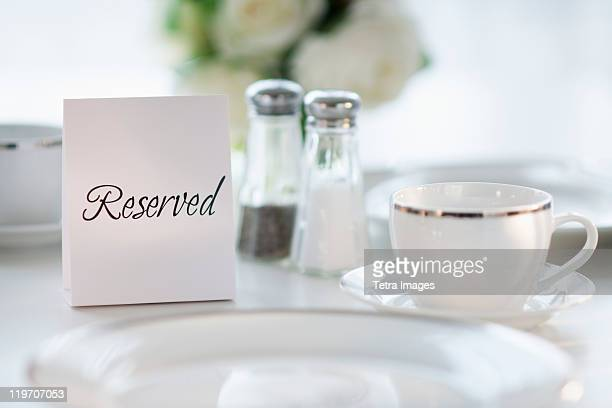 Close up of place setting with reserved sign