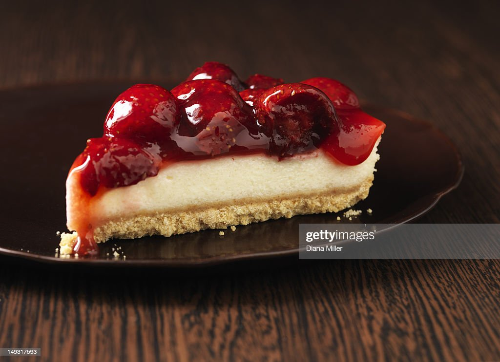 Close up of plate of fruit cheesecake : Stock Photo