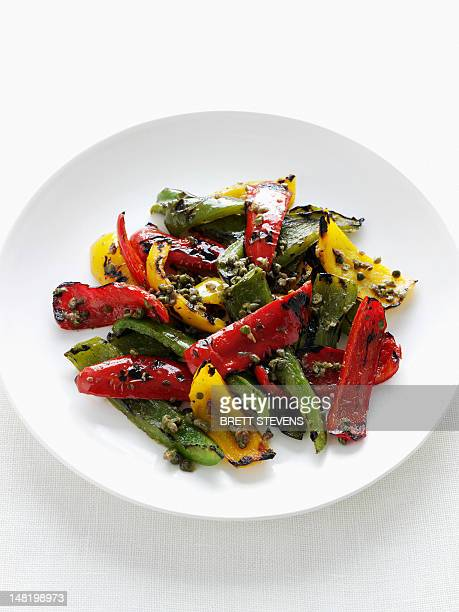 close up of plate of grilled peppers - roasted pepper stock photos and pictures