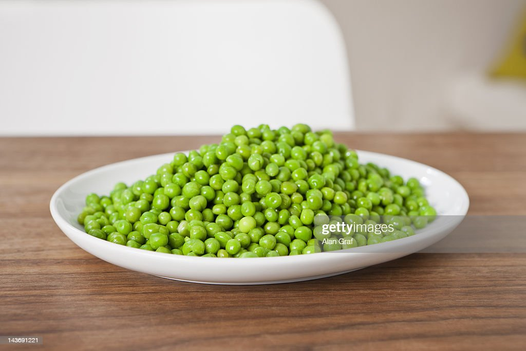 Close up of plate of peas on table : Stock Photo