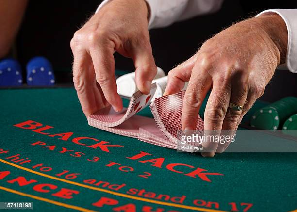 close up of poker player's hands - shuffling stock photos and pictures