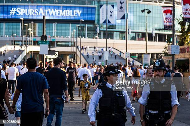 Close up of police and supporters outside Wembley Stadium, London