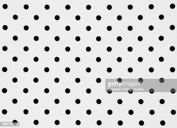 close up of polka dots over white background - motivo ornamentale foto e immagini stock