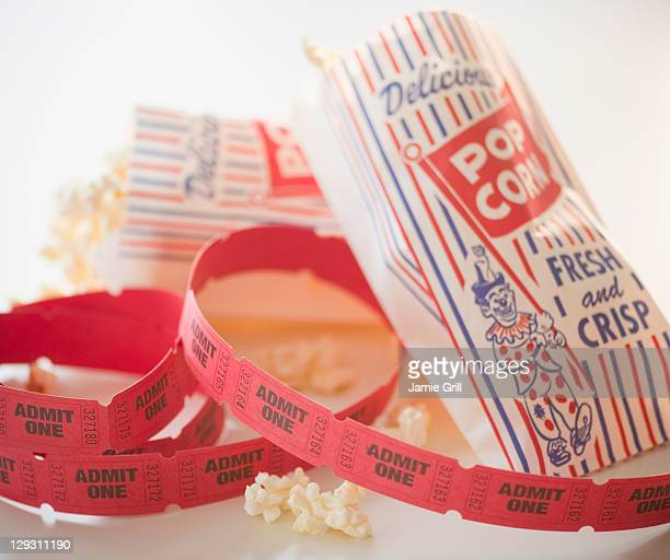 Close up of popcorn and tickets