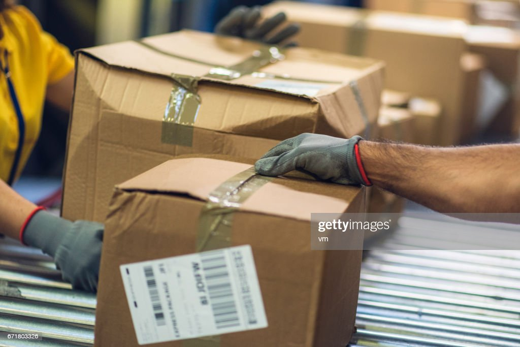 Close up of postal workers handling damaged packages : Stock Photo
