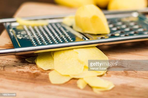 Close up of potato on grater