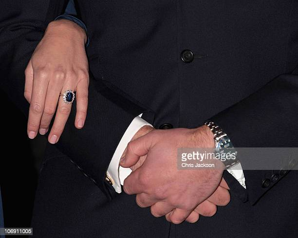 A close up of Prince William's watch and Kate Middleton's engagement ring as they pose for photographs in the State Apartments of St James Palace on...