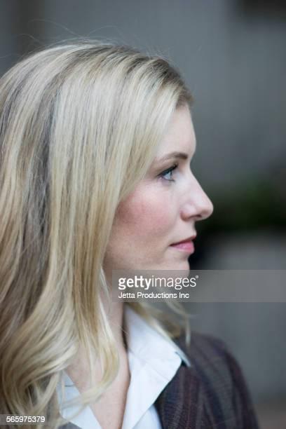Close up of profile of Caucasian businesswoman