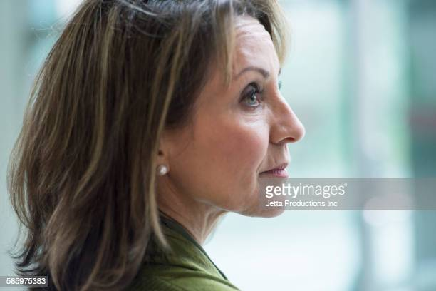 Close up of profile of Caucasian woman