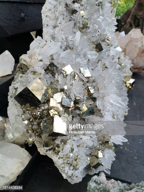 close up of pyrite on white crystal cluster - 金属鉱石 ストックフォトと画像