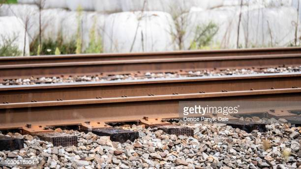 close up of railroad rail and track - panyik-dale stock photos and pictures