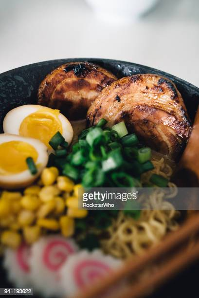 A close up of ramen ingredients in a bowl