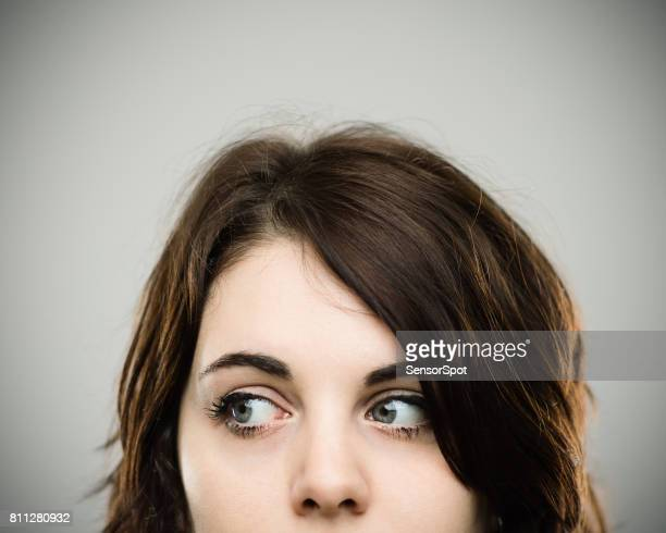 Close up of real young woman looking away