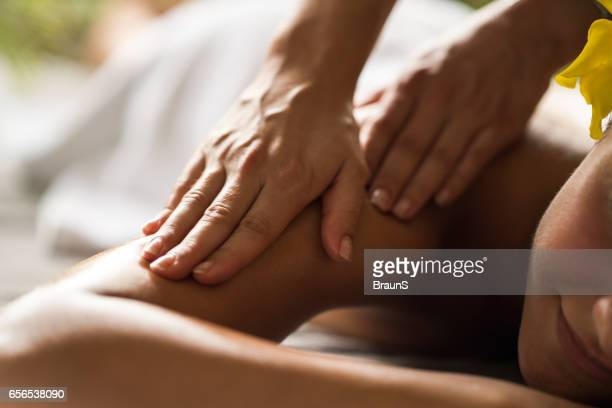 close up of receiving relaxing massage at the spa. - massaggi foto e immagini stock
