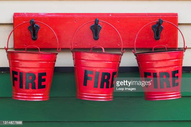 Close up of red fire buckets hanging on the platform.