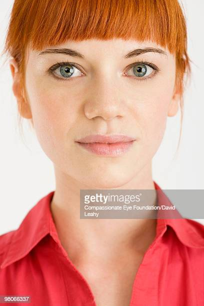 "close up of red haired woman - ""compassionate eye"" stock-fotos und bilder"